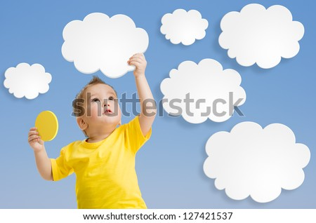 Kid or child keep cloud and sun in his hands - stock photo