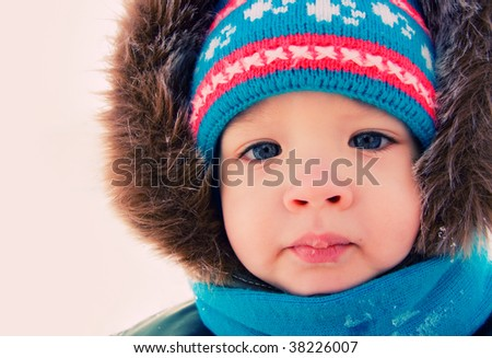 Kid outdoor snow winter. Christmas time - stock photo