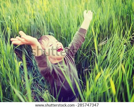 Kid outdoors having fun - stock photo