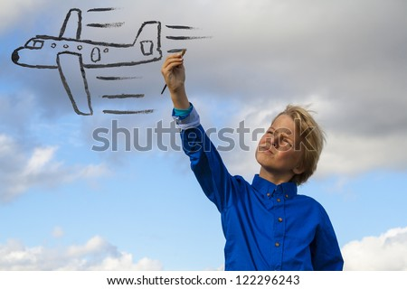 kid painting airplane - stock photo