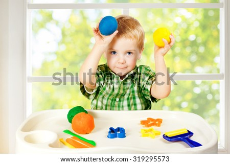 Kid Play Modeling Plasticine, Child Mold Colorful Clay Dough, Preschooler Education Toys - stock photo
