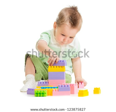 Kid playing colorful toy building blocks - stock photo