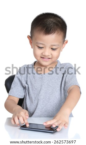 Kid playing games with  cell phone - stock photo