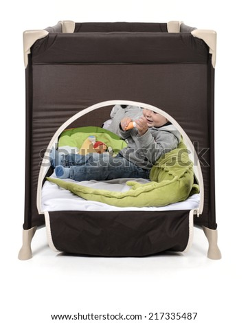 Kid playing in his playpen bed - stock photo