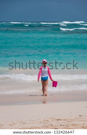 Kid Playing on the Beach, Punta Cana, Dominican Republic - stock photo