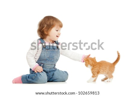 kid playing wit cat - stock photo