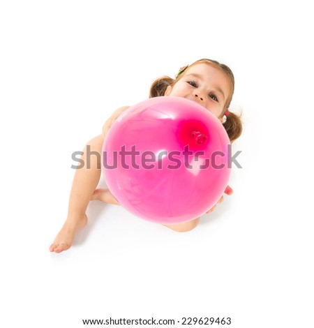 Kid playing with balloons over white background - stock photo