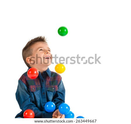 Kid playing with colored balls  - stock photo