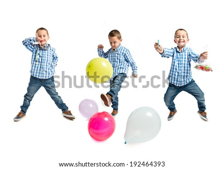 Kid playing with colorful balloons and sweets over white background  - stock photo