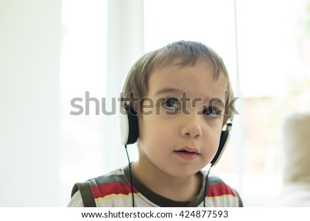 Kid playing with digital tablet - stock photo