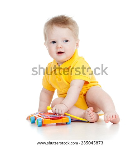 kid playing  with musical toy isolated - stock photo