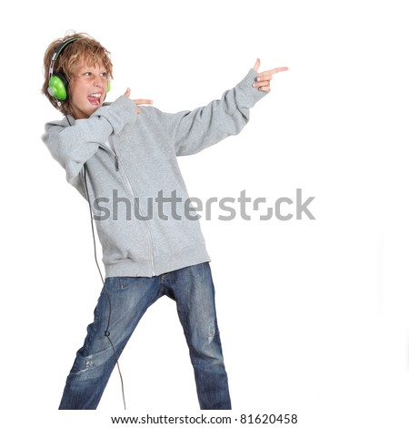 kid pointing and listening to music - stock photo