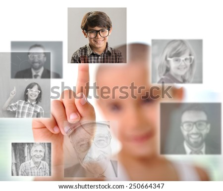 Kid pressing digital button with people faces - stock photo