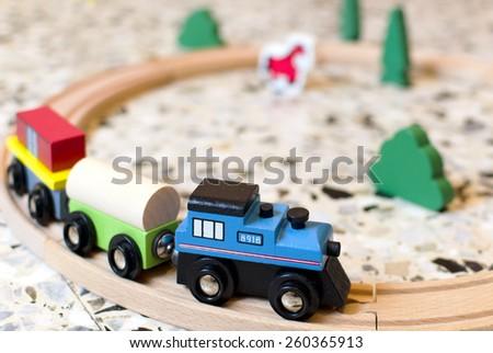 Kid's wooden train on tracks - stock photo
