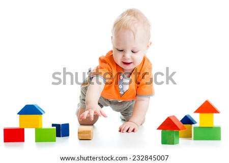 kid toddler playing with block toys over white background - stock photo