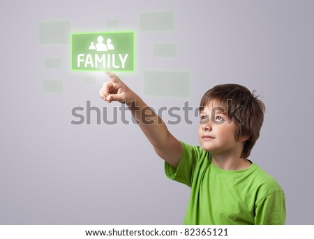 Kid touching FAMILY button on a touchscreen - stock photo
