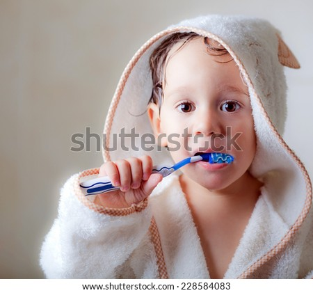kid wash his teeth  - stock photo