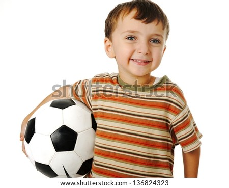 Kid with a ball for soccer - stock photo