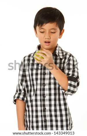 Kid with green apple isolated on white background - stock photo
