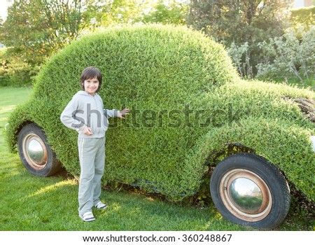 Kid with green car - stock photo