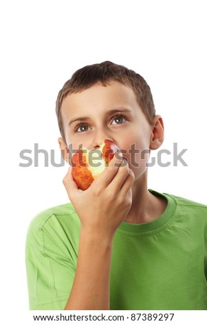 Kid with red apple isolated on white background - stock photo