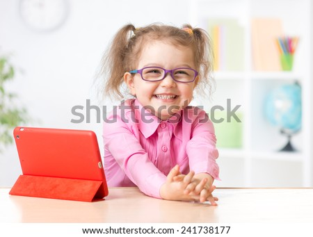kid with tablet in glasses as early education concept - stock photo