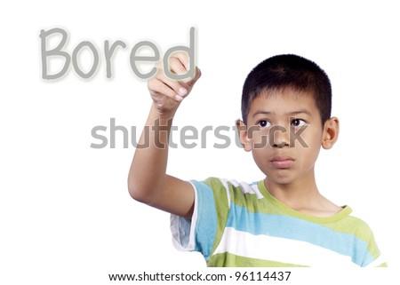 Kid writing bored on white background - stock photo