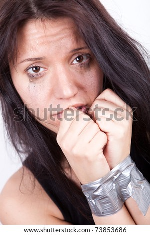 kidnapped young woman, hostage closeup on white background - stock photo