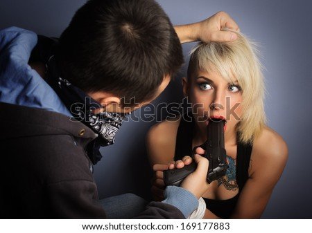 Kidnapper harassing a young woman. Focus on women face. - stock photo