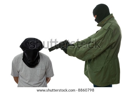 Kidnapper holding a gun to the head of a hooded man. - stock photo