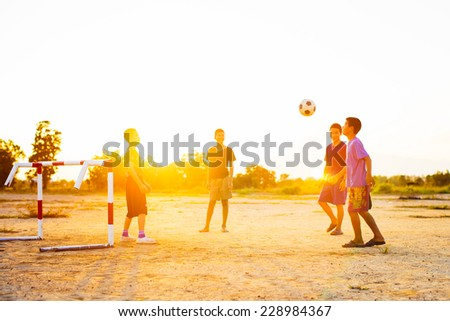 kids are playing soccer football - stock photo