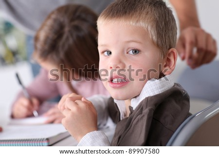 Kids at school doing their homework - stock photo