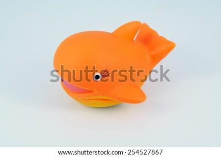 Kids bathing toy. Children bath toy. Orange  Whale toy. - stock photo
