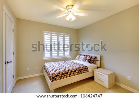 Kids bedroom with minimal design and beige walls. - stock photo