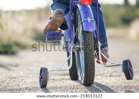 Kids bike with training wheels closeup - stock photo