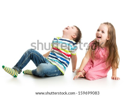kids boy and girl looking up - stock photo