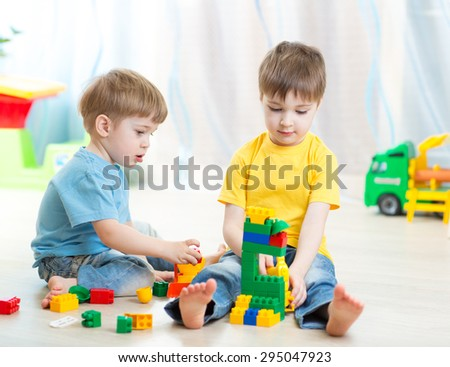 kids boys playing in playschool or at home - stock photo
