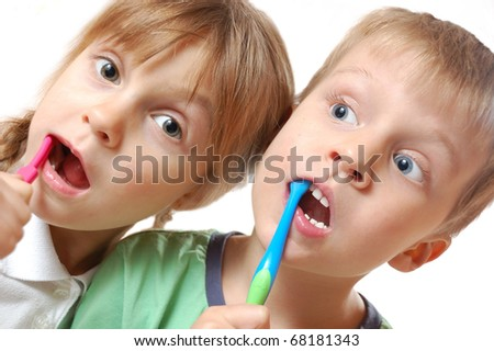 kids brushing their teeth over white background - stock photo
