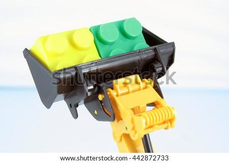 Kids bulldozer toy . - stock photo