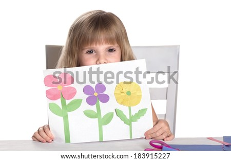 Kids crafts .  Child showing her crafts. - stock photo