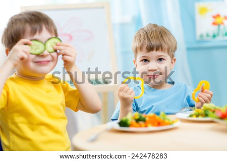 kids eating healthy food in kindergarten or at home - stock photo
