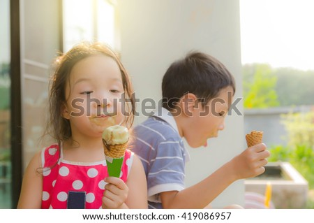 kids eating ice cream - stock photo