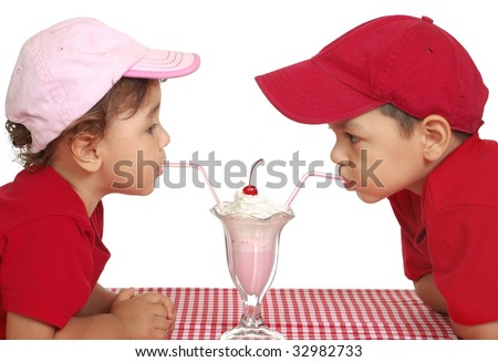 kids eating ice cream, two and three years old - stock photo