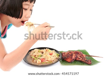 "kids  eating  ""Somtum"" and ""Gaiyang"" in Thai, or Papaya spicy salad and Grilled Chicken,Famous Thai food. isolated on white background - stock photo"