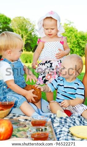 Kids enjoying picnic time - stock photo