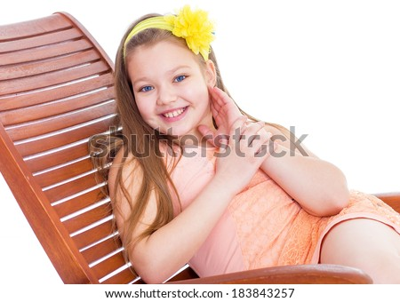 Kids,girl,child and  - orange .A young girl on vacation in the summer with a glass of juice. Isolated on white background. - stock photo