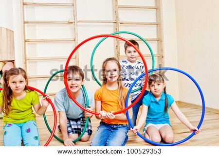 Kids group with colorful hula hoops - stock photo
