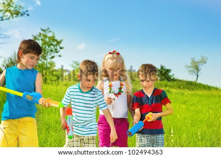 Kids group with water pumpers - stock photo