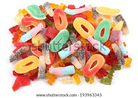 Kids gummy candies or sweets in multi colors and a variety of shapes. - stock photo