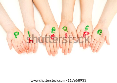 Kids hands begging and painted with the words please help. - stock photo